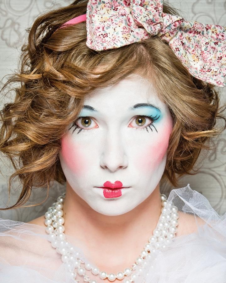 a girl dressed up as an old vintage porcelain doll
