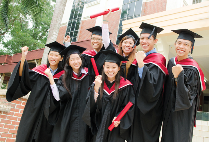 Asian university students celebrate their graduation