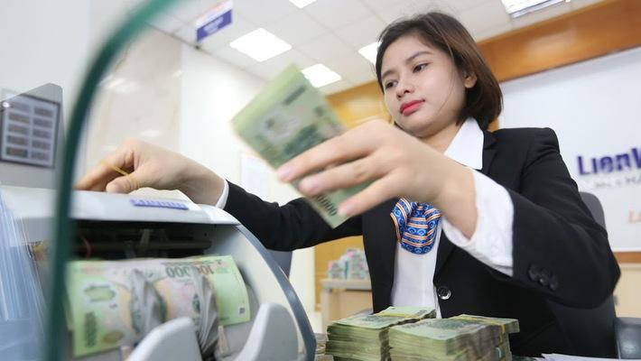 Hỗ trợ cho kế hoạch chào sàn, các ngân hàng nói chung đang khởi đầu 2018 với tăng trưởng lợi nhuận tốt hơn nhiều năm qua - Ảnh: Quang Phúc.
