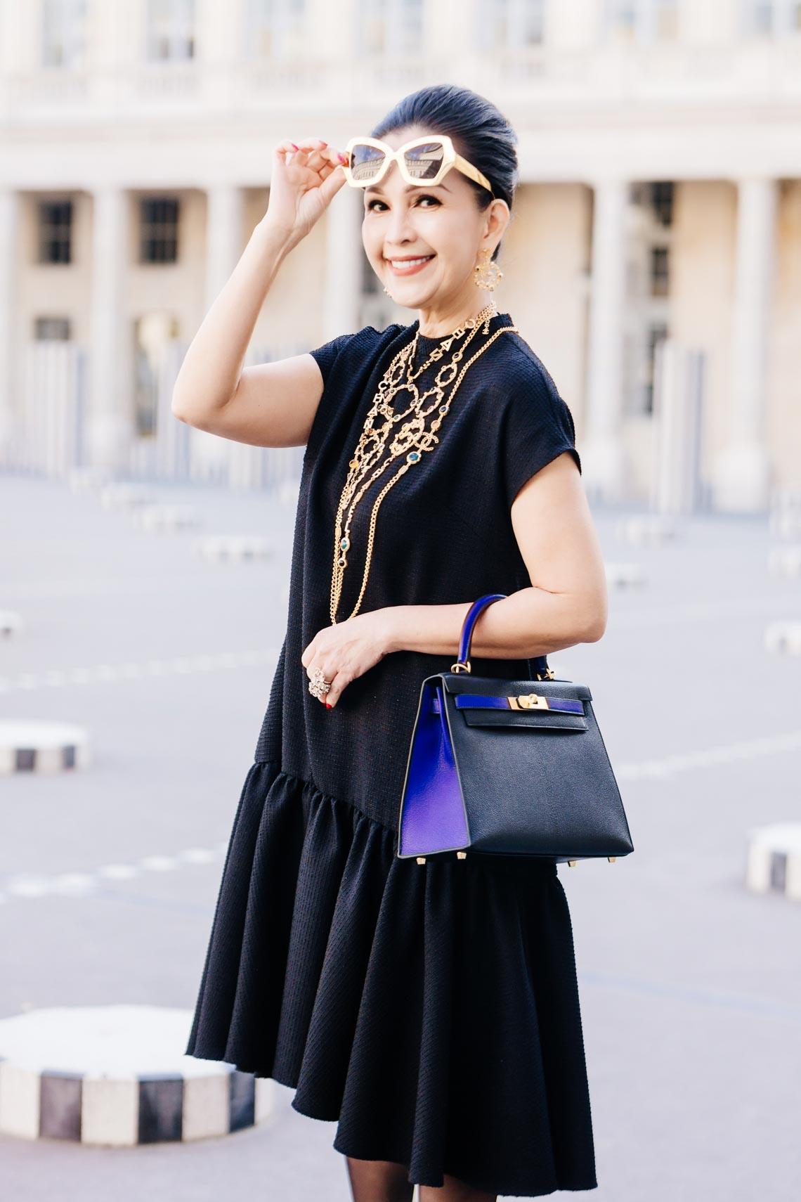 Diễm My sang trọng trong trang phục trắng đen dạo phố Paris - 2