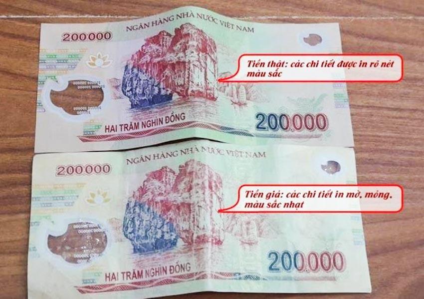 Ngân hàng Nhà nước khuyến cáo người tiêu dùng kiểm tra đồng tiền khi giao dịch tiền mặt -1