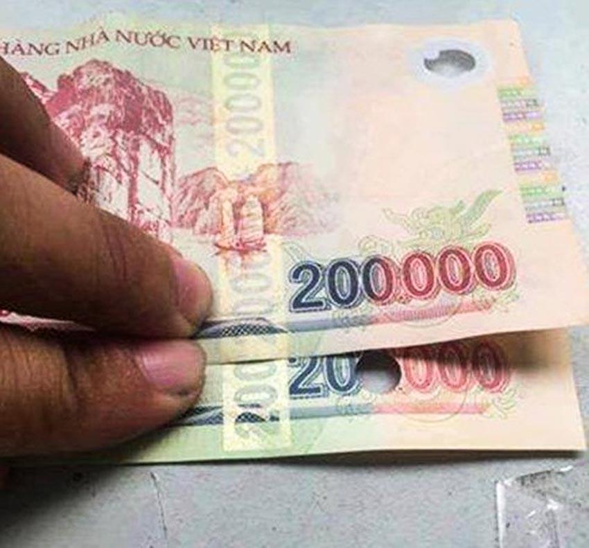 Ngân hàng Nhà nước khuyến cáo người tiêu dùng kiểm tra đồng tiền khi giao dịch tiền mặt -3