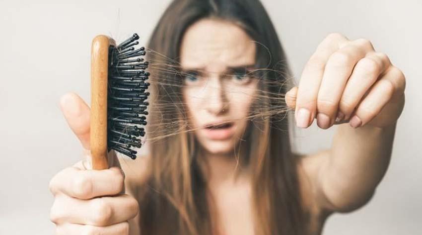 Nguyên nhân khiến mái tóc của phái đẹp rụng tả tơi -1